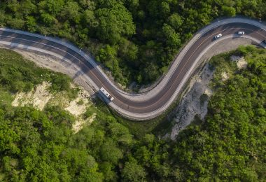 Curvy switchback highway with hairpin turns snaking through the woods